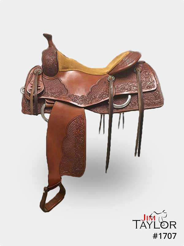 Brown cow horse western saddle