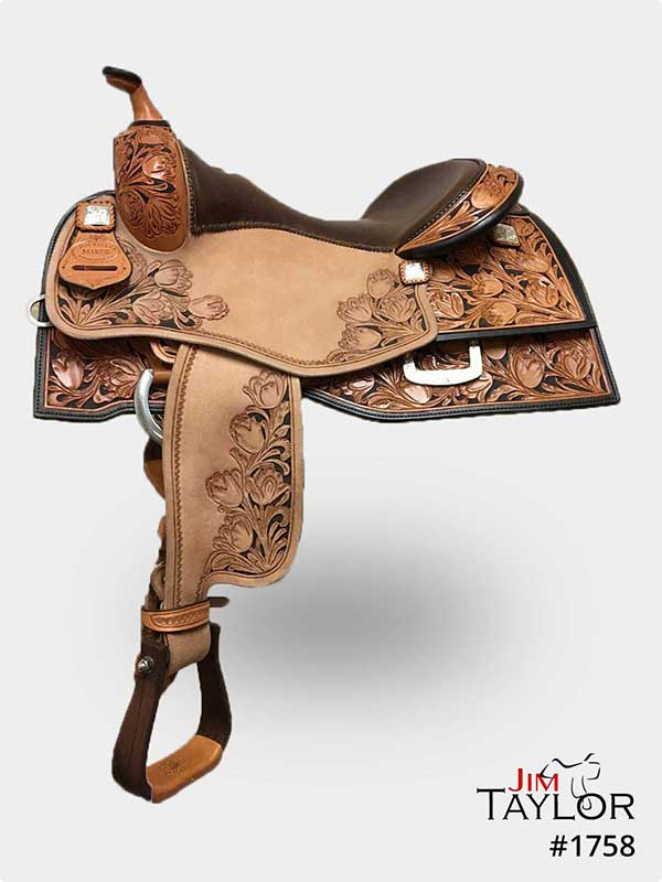 Light brown western saddle with tooling