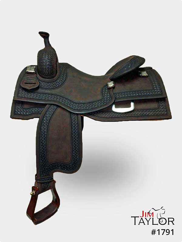 Dark brown and black western cow horse saddle